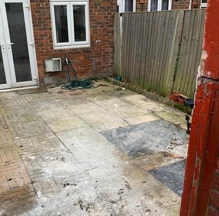 backyard after mattress and carpet clearance