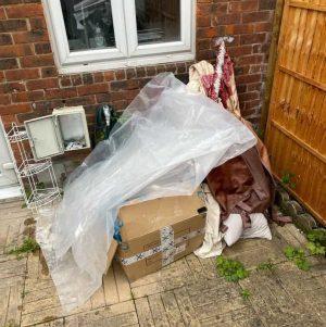 accumulated rubbish in the backyard